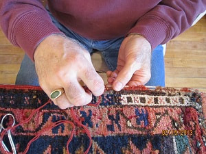 Hand repair of Oriental Rugs